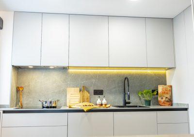 cocina_moderna_abierta_cerrajeria_encimera_neolith_-6